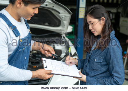 car salesman is making deal with lender. Used cars cheaper than new cars. But to buy a used car - Stock Photo