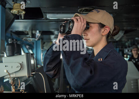 170619-N-BL637-152  PACIFIC OCEAN (June 22, 2017) Lt. Jillianne Planeta stands the officer of the deck watch on the bridge of the Nimitz-class aircraft carrier USS Carl Vinson (CVN 70) in the Pacific Ocean. The U.S. Navy has patrolled the Indo-Asia-Pacific routinely for more than 70 years promoting regional peace and security. (U.S. Navy photo by Mass Communication Specialist 2nd Class Sean M. Castellano/Released) - Stock Photo