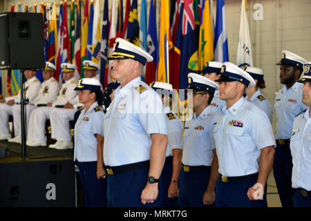 The Coast Guard Seventh District crew stands at attention during their Change of Command Ceremony at Air Station Miami on June 23, 2017. Coast Guard Rear Adm. Peter J. Brown relieved Rear Adm. Scott A. Buschman as commander of the Seventh District. - Stock Photo