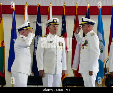 The Coast Guard Rear Adm. Scott A. Buschman passes command of the Seventh District to Rear Adm. Peter J. Brown during the Change of Command Ceremony at Air Station Miami on June 23, 2017. - Stock Photo