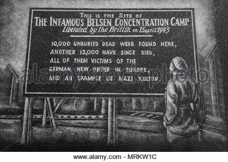 Etching at the Holocaust Memorial in Toronto, Canada depicting the sign outside the Belsen concentration camp. - Stock Photo
