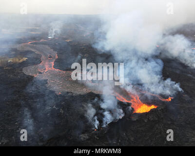 Channelized lava streams down fissure 22 in the East Rift Zone from the eruption of the Kilauea volcano May 24, 2018 in Pahoa, Hawaii. - Stock Photo