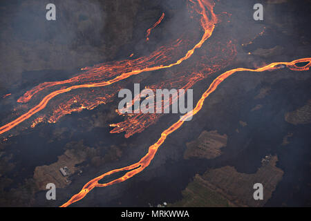 Channelized lava streams down the East Rift Zone from the eruption of the Kilauea volcano May 23, 2018 in Pahoa, Hawaii. - Stock Photo