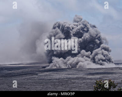 An ash plumes rises thousands of feet at the summit of the Kilauea volcano May 23, 2018 in Pahoa, Hawaii. - Stock Photo