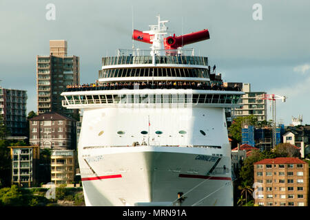 SYDNEY, AUSTRALIA - April 4, 2018: Carnival Spirit cruise ship leaving docs of Circular Quay - Stock Photo