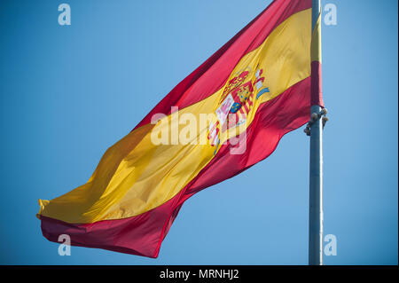 Malaga, Spain. 27th May, 2018. A Spanish flag is seen during the parade to commemorates the Armed Forces Day, which its celebrated every 26 may in Spain.The Spanish Arm Forces Day is being celebrated in the City of Malaga with members of the arm forces paraded in the city center. Credit: Jesus Merida/SOPA Images/ZUMA Wire/Alamy Live News - Stock Photo