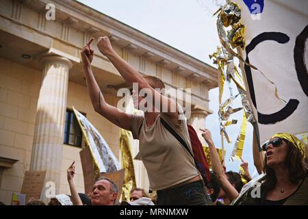 A woman seen giving the middle finger during the demonstration. Techno lovers and anti racism activists have marched in Berlin against a rally organised by the German far-right party, AFD. Over 70.000 people (according to the organisers) have taken the streets of Berlin with a huge party organised by some of the most famous Berlin techno clubs. Several counter demos have taken place along the German capital to protest against the AFD rally that has started at the main train station and finished at the Brandenburger Tor with hundreds of attendants. - Stock Photo