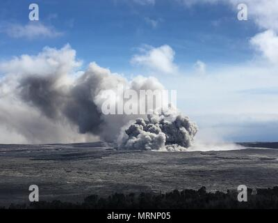 An ash plumes rises from the Halemaumau crater at the summit of the Kilauea volcano May 23, 2018 in Pahoa, Hawaii. - Stock Photo