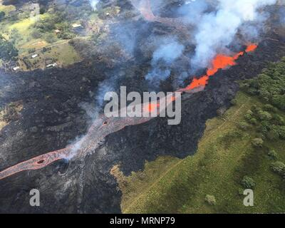 Channelized lava streams down fissure 20 in the East Rift Zone from the eruption of the Kilauea volcano May 19, 2018 in Pahoa, Hawaii. - Stock Photo
