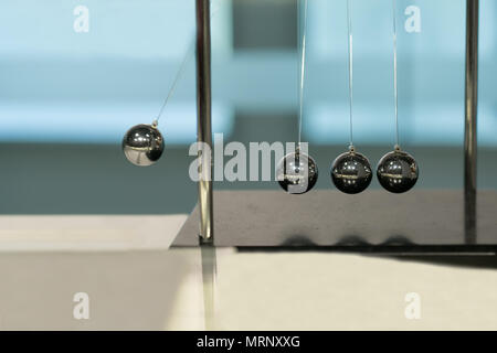 Balancing Balls Newton's Cradle on blurred backgrounds - Stock Photo