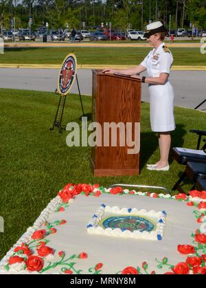 CAMP LEJEUNE, NC -- Captain Shelley Perkins, executive officer of Naval Medical Center Camp Lejeune served as the emcee for the ribbon cutting ceremony marking the renaming of Naval Hospital Camp Lejeune to Naval Medical Center Camp Lejeune, June 27, 2017.  The ceremony was the formal recognition of years of growth and hard work by the thousands of Corpsmen, nurses, doctors, civilian sailors and staff who've served at the hospital. Originally built in 1983, the current hospital has grown significantly over the last decade adding new services such as operating the Navy's only Level II Special C - Stock Photo