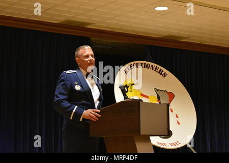"""25th Space Range Squadron collectively celebrate the squadron's 100th birthday during the 25 SRS Centennial Dinner Banquet at Peterson Air Force Base, Colorado, Wednesday, June 21, 2017. The 25 SRS extended invitations to any and all """"Executioners"""" to celebrate this momentous milestone. (U.S. Air Force photo/2nd Lt. Scarlett Rodriguez) - Stock Photo"""