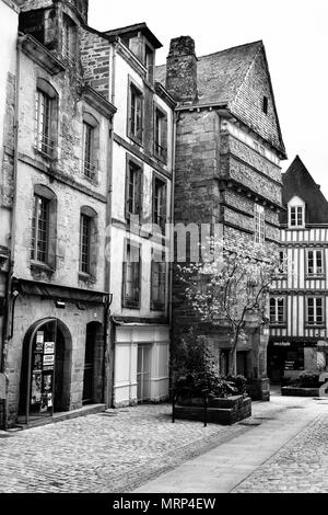 Half-timbered and stone buildings in the old medieval city of Quimper, Brittany, France. Black & white. B&W - Stock Photo