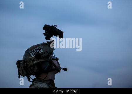 U.S. Air National Guard Senior Airman Michael Curley from the 227th Air Support Operations Squadron watches hoist operations during joint training for New Jersey Task Force One at Joint Base McGuire-Dix-Lakehurst, N.J., June 28, 2017. The primary mission of New Jersey Task Force One is to provide advanced technical search and rescue capabilities to victims trapped or entombed in structurally collapsed buildings. Task Force One is made up of New Jersey National Guard Soldiers and Airmen, as well as civilians. (U.S. Air National Guard photo by Master Sgt. Matt Hecht/Released) - Stock Photo