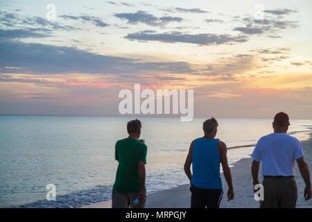 Sanibel Island Florida Gulf of Mexico sunset dusk beach sand water beachcomber - Stock Photo