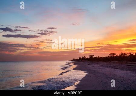 Sanibel Island Florida Gulf of Mexico sunset dusk beach sand water - Stock Photo