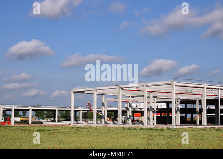 factory construction site with workers industry zone - Stock Photo