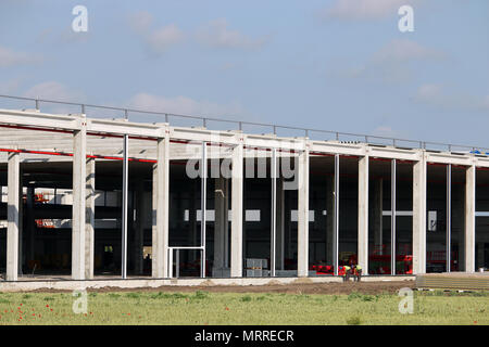 New factory construction site with workers industry zone - Stock Photo