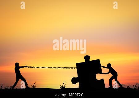 silhouette of man pull jigsaw, teamwork concept - Stock Photo