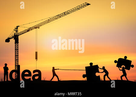 Silhouette of men helping push and pull puzzle, concept as teamwork and team - Stock Photo