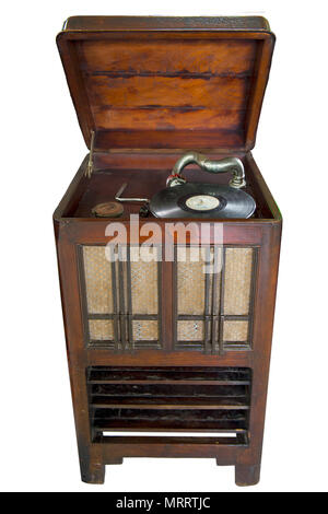 Vintage Vinyl Record Player : old retro vinyl record player set in wooden cabinet on isolated white background with clipping path. - Stock Photo
