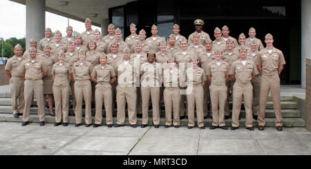 170628-N-XX082-001  VIRGINIA BEACH, Va. (June 28, 2017) Students from the Information Professional Basic Course and Naval Intelligence Officer Basic Course at Information Warfare Training Command (IWTC) Virginia Beach pose for a photo with course instructors and IWTC Virginia Beach leadership prior to their graduation ceremony. (U.S. Navy photo by Intelligence Specialist 1st Class Christina Wilson/Released) - Stock Photo