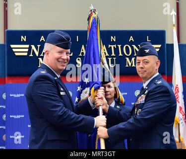 Col. Joel Carey, 12th Flying Training Wing commander, receives the guidon from Col. John Edwards as he relinquishes command of the 479th Flying Training Group during a change of command ceremony June 30, 2017 at the National Naval Aviation Museum, Naval Air Station Pensacola, Fla. (U.S. Air Force photo by Tech. Sgt. Ave I. Young) - Stock Photo
