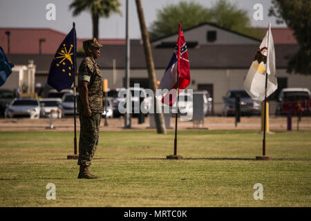 U.S. Marine Corps Staff Sgt. Matthew Bradley, the adjutant for the ceremony, calls troops to order during Sgt. Maj. Delvin R. Smythe's, the Marine Corps Air Station Yuma, Ariz., sergeant major, retirement ceremony, June 30, 2017. (U.S. Marine Corps photo taken by Lance Cpl. Christian Cachola) - Stock Photo