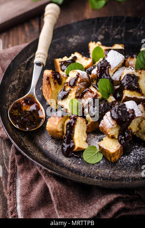 Cutted pancakes, Kaiserschmarrn delish dessert with plums, food photography, food stock - Stock Photo