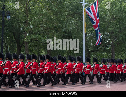 Soldiers with rifles marching down The Mall in London UK. Photo taken during the Trooping the Colour military ceremony - Stock Photo