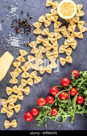 Food background Uncooked Pasta Macaroni Farfalle - Stock Photo