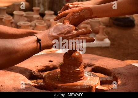 Traditional Indian potter making clay pot  on Pottery wheel - Stock Photo