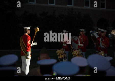 U.S. Marines with the United States Marine Drum and Bugle Corps perform during an evening parade at Marine Barracks Washington, Washington, D.C., June 30, 2017. Evening parades are held as a means of honoring senior officials, distinguished citizens and supporters of the Marine Corps. (U.S. Marine Corps photo by Cpl. Christian Varney - Stock Photo