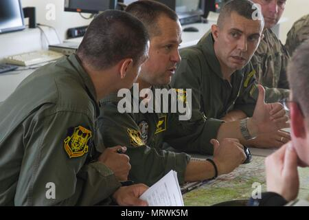 Bulgarian Air Force pilots help to plan an upcoming combat search and rescue mission as part of exercise Saber Guardian 17 at Plovdiv, Bulgaria, on July 10. By synchronizing each other's communications systems, flight patterns, and answering questions, a deeper level of understanding is reached by each side and interoperability between NATO Allies is acheived. (U.S. Army photo by Spc. Thomas Scaggs) 170710-A-TZ475-077 - Stock Photo