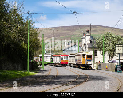 Manx Electric Railway trains passing near station in Laxey, Isle of Man, British Isles - Stock Photo