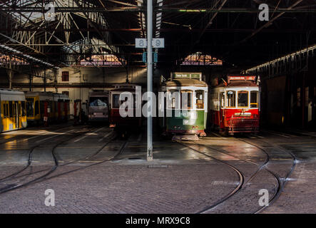 Lisbon, Portugal 2017 - Famous old historical retro trams hidden under roof in a tram depot waiting for another journey - Stock Photo