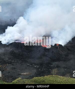 Lava and poisonous sulfur dioxide plumes rise as molten magma spews from fissure 22 from the eruption of the Kilauea volcano May 26, 2018 in Pahoa, Hawaii. - Stock Photo