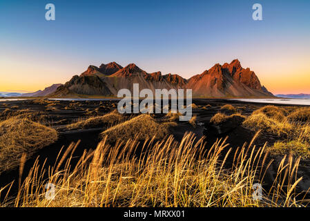 Stokksnes, Hofn, Eastern Iceland, Iceland. Vestrahorn mountain and the black sand dunes at sunset. - Stock Photo