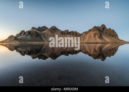 Stokksnes, Hofn, Eastern Iceland, Iceland. Vestrahorn mountain mirrors in the waters of the Stokksnes bay. - Stock Photo