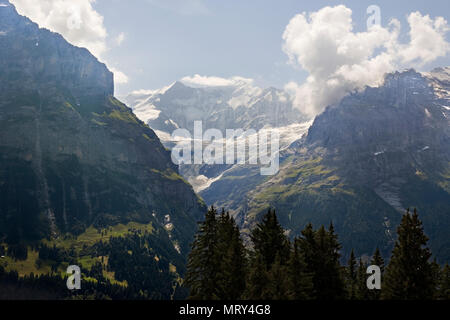 The valley of the Oberer Grindelwaldgletscher taken from the First cablecar across the Lüschental, Bernese Oberland, Switzerland - Stock Photo