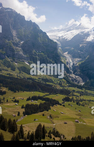 The valley of the Oberer Grindelwaldgletscher with the Schreckhorn beyond, taken from the First cablecar, Bernese Oberland, Switzerland - Stock Photo