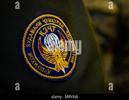 A military patch adorns the uniform of a Tajikistan solider during