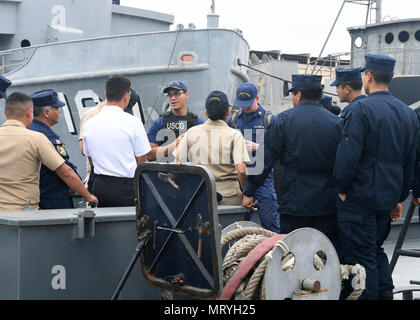 170716-N-PQ607-062  LIMA, Peru (July 16, 2917) - U.S. Coast Guard Ens. Joaquin Reyes conducts a maritime law enforcement symposium with UNITAS partner nation participants from Mexico, Peru, Honduras and Chile onboard a Peruvian naval vessel. UNITAS is an annual exercise that focuses on strengthening our existing regional partnerships and encourages establishing new relationships through the exchange of maritime mission-focused knowledge and expertise throughout the exercise. (U.S. Navy photo by Mass Communication Specialist 2nd Class Michael Hendricks/Released) - Stock Photo