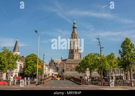 Bridge and main street entrance to the city of Breda. Stresses the tower of the great church of Breda. Netherlands - Stock Photo