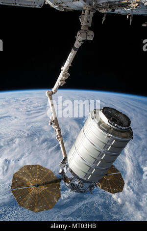 The Orbital ATK Cygnus cargo spacecraft is grabbled by the Canada Arm 2 for docking with the International Space Station May 24, 2018 in Earth Orbit. - Stock Photo