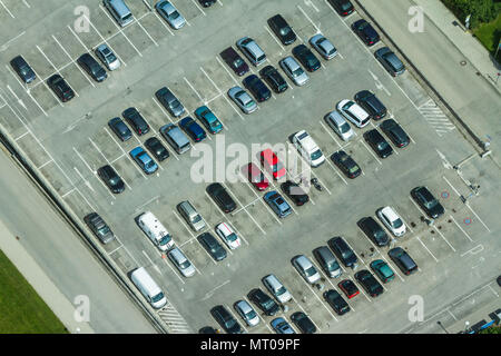 Aerial view of a parking lot with many cars in rows in Munich, Germany - Stock Photo