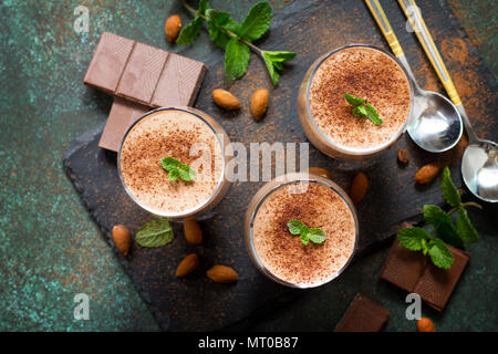Homemade coffee-chocolate mousse on a stone or slate background. - Stock Photo