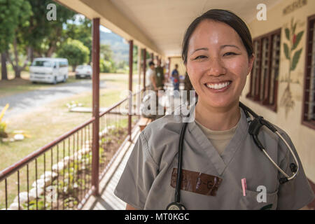U.S. Air Force Maj. Lisa Dodobara-Griffith, a family physician and the primary care flight commander with the 35th Medical Operations Squadron at Misawa Air Base, Japan, smiles for the camera while taking a break during Pacific Angel 17-3 at the Tagitagi Sangam School and Kindergarten in Tavua, Fiji, July 17, 2017. Dodobara-Griffith joined seven other Misawa Airmen for the exercise that improves interoperability between the United States and multinational partners in the Indo-Asia-Pacific region. (U.S. Air Force photo/Tech. Sgt. Benjamin W. Stratton) - Stock Photo