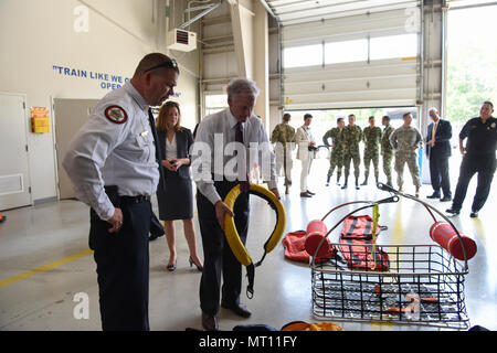 Gov. of South Carolina Henry McMaster visited with the South Carolina National Guard's Helicopter Aquatic Rescue Team (SC-HART) at the South Carolina Fire Academy in Columbia, South Carolina July 20, 2017.  The SC-HART Team reviewed training techniques they use to save lives, including a water litter rescue demonstration. (U.S. Army National Guard photo by Spc. Chelsea Baker) - Stock Photo