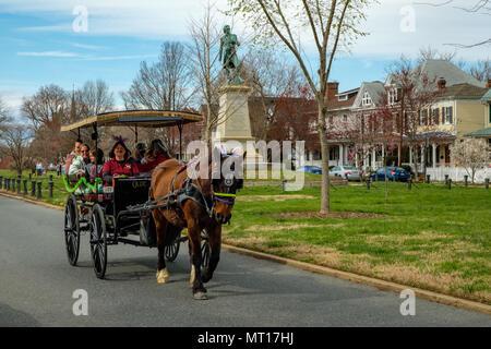 Horse with easter bunny ears, Olde Towne Carriage ride, passing Hugh Mercer Statue, Washington Avenue, Fredericksburg, Virginia - Stock Photo